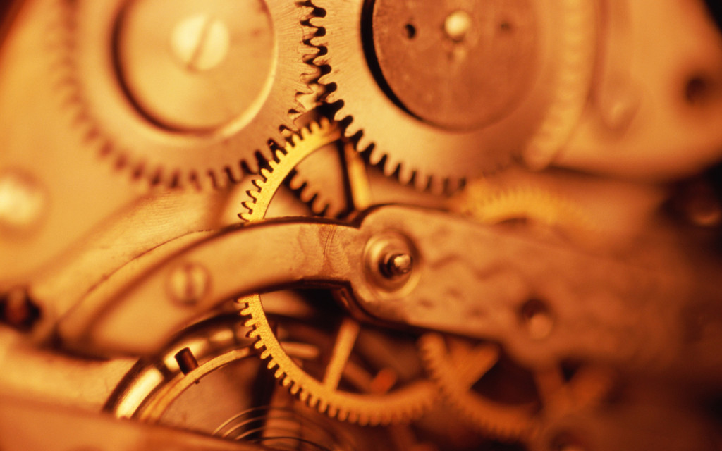 Interlocking gears in clockwork mechanism, close-up (sepia tone)